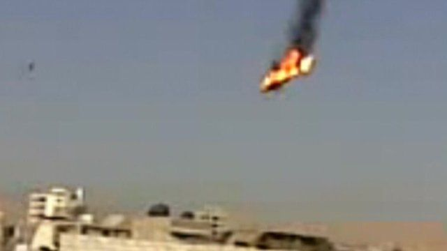 Still from unverified amateur footage, 27/08/12, purporting to show a helicopter in flames after being shot by rebels in the Al Qabun area of Damascus