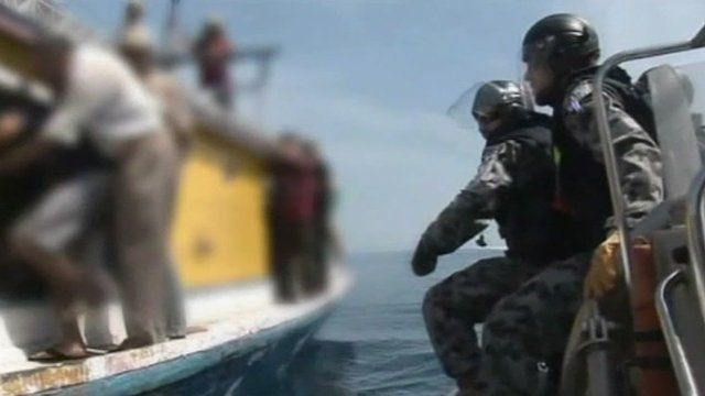 Armoured police boarding asylum seeks boat