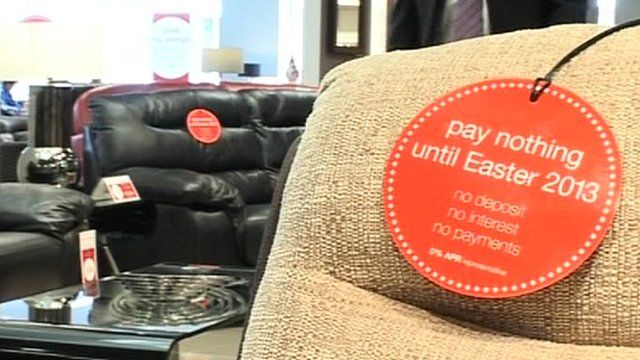 """Furniture in store with """"buy now pay later"""" tags"""