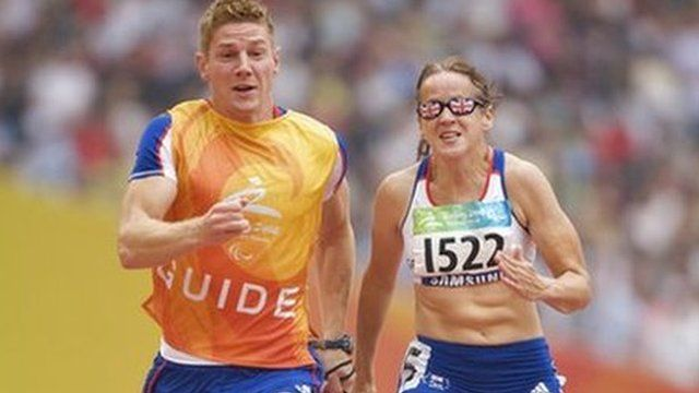 Tracey Hinton running with her guide runner Steffan Hughes