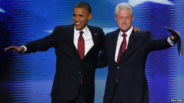 Barack Obama and Bill Clinton arm in arm