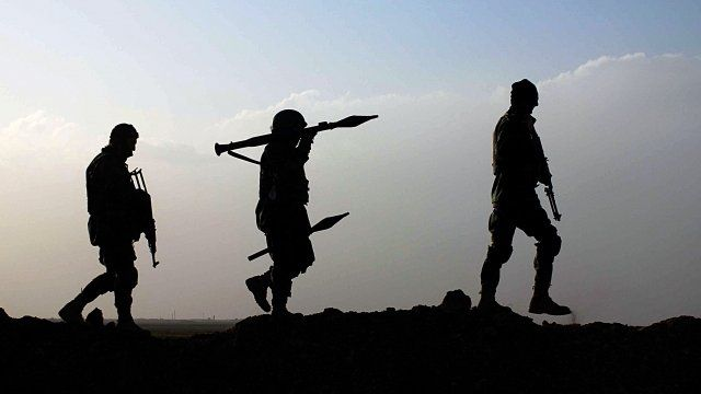 Afghan National Army soldiers in silhouette