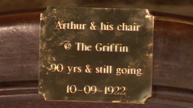 The brass plaque on Arthur Reid's chair in his local pub
