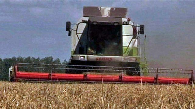 Harvester in field