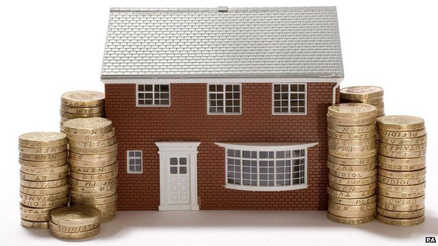 detached model house with pound coins