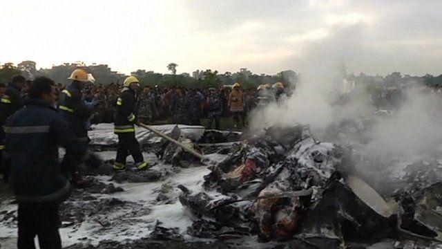 Kathmandu fire teams hosing down wreckage