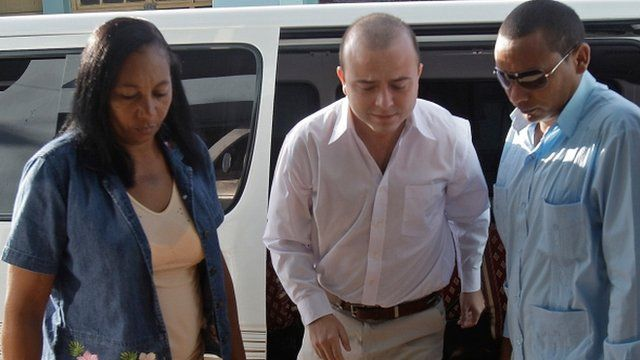 Cuban security forces escort Spanish citizen Angel Carromero, centre, to the courthouse to attend his trial in Bayamo