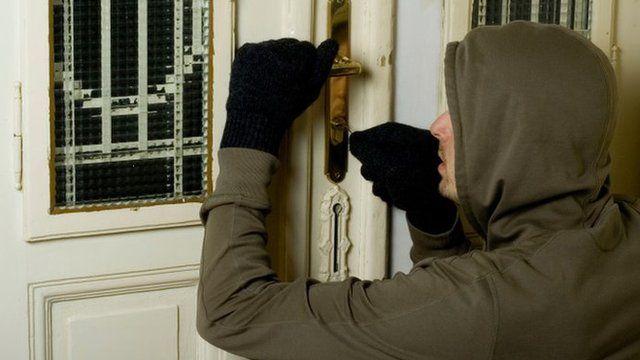 Burglar picking a lock