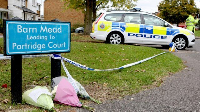 Floral tributes laid at Barn Mead following a house fire in the street in Harlow, Essex,