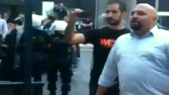 Golden Dawn MP Ilias Panagiotaros (right)