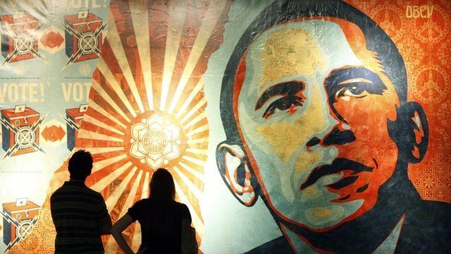 People in front of Shepard Fairey's 'Hope' poster in 2008