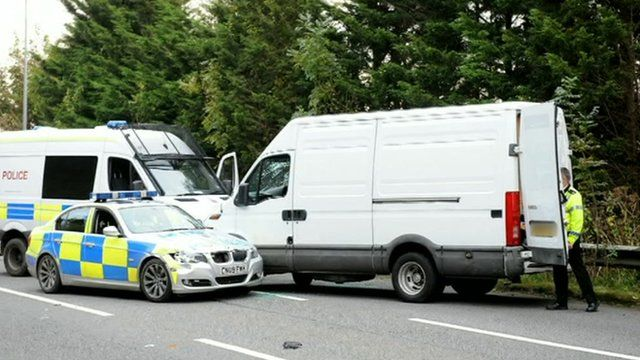 A white van was stopped by police on the outskirts of Cardiff