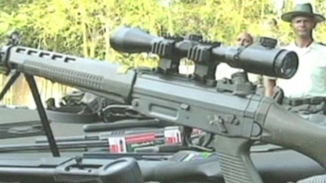 Police seized rifles, grenades and crossbows in Sosua