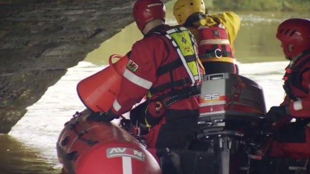 Men in boat search water