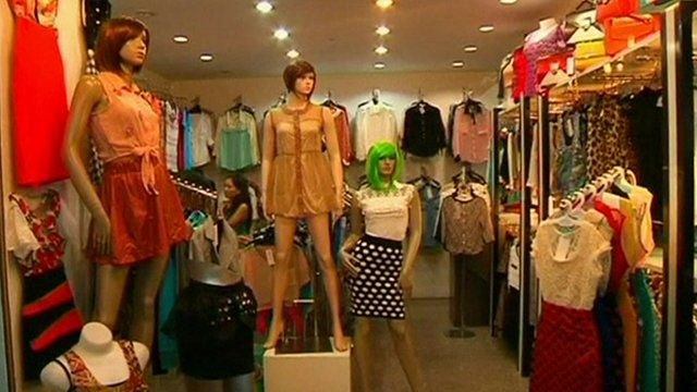 A selection of different clothing in a shop
