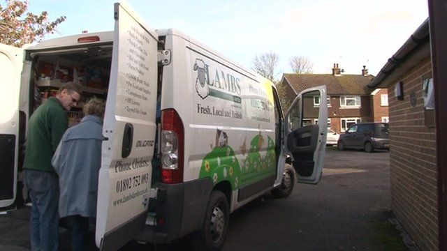 Peter Lamb with a customer outside his van