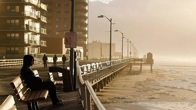 The heavy surf breaks against the boardwalk in Long Beach, New York