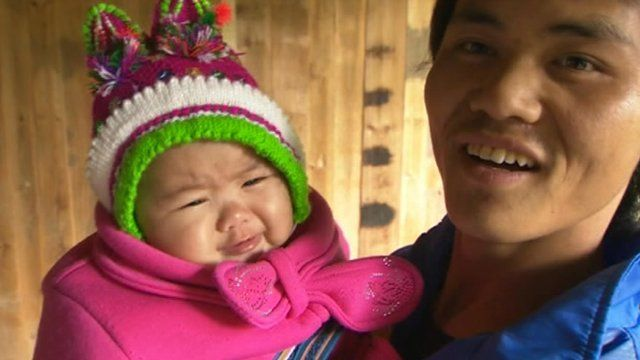 A man holding his one year old baby