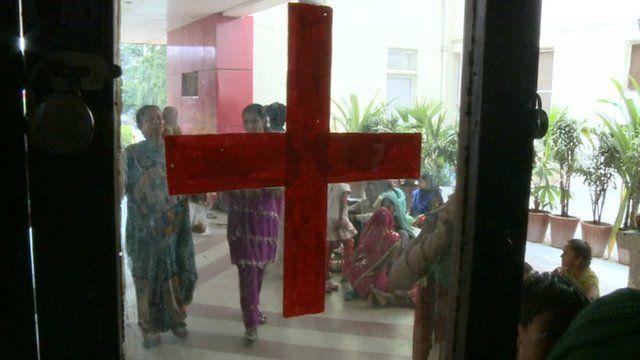 Red cross on glass door