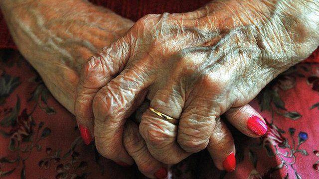 An elderly person's hands