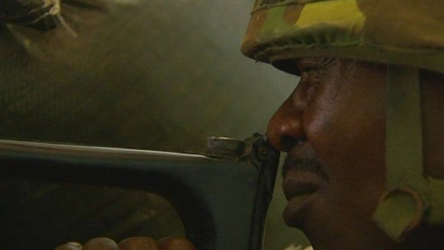 Uganda soldier aims weapon