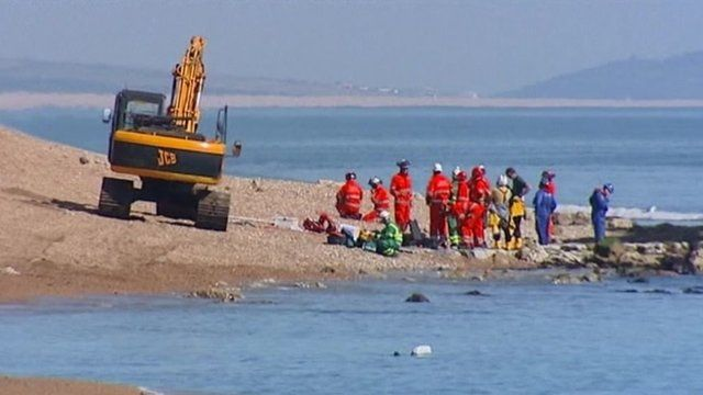 Emergency services on the Dorset beach where Charlotte Blackman was killed
