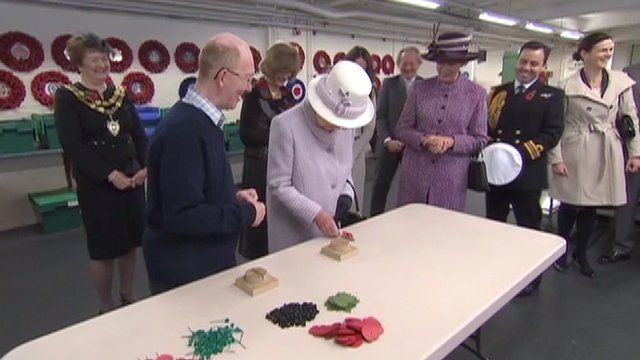 The Queen making a poppy at the Poppy Factory in Richmond