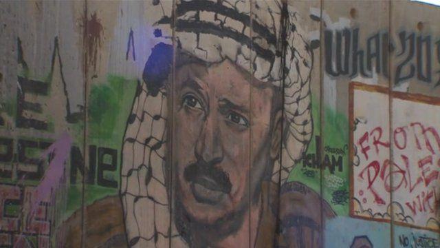 Graffiti images of Yasser Arafat have been sprayed across blast walls