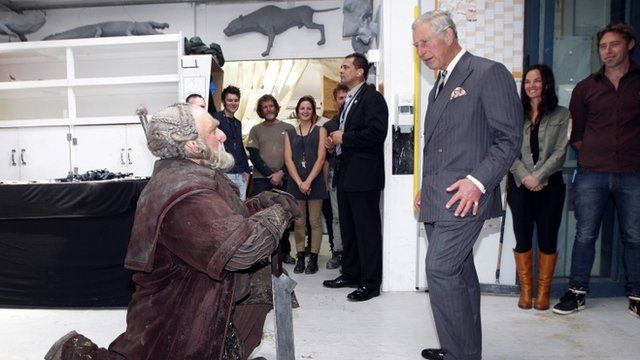 """Prince Charles (R) meets with Mark Hadlow who plays the dwarf Dori (L) in the upcoming Hobbit movie during his visit to Peter Jackson""""s Weta Workshop in Wellington"""