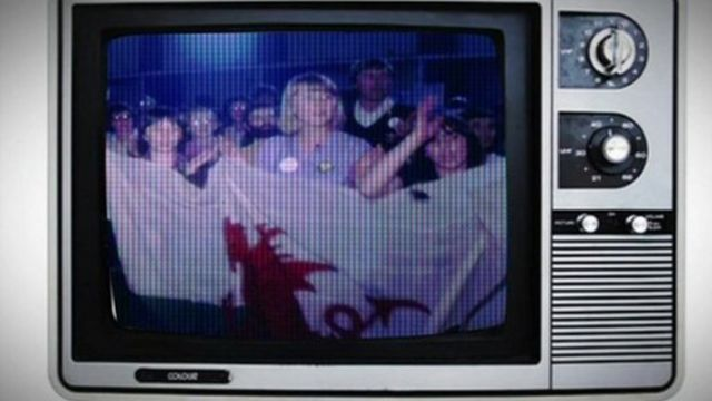 People holding a Welsh flag 30 years ago during campaigns for a Welsh TV channel