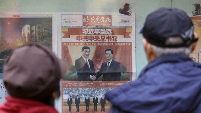 Chinese couple looking at newspaper