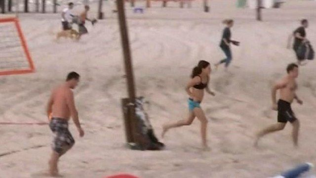 People on the beach fled as sirens sounded in Tel Aviv on Saturday
