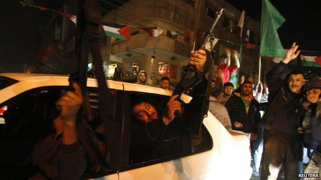 A Palestinian gunman fires into the air as he celebrates what Palestinians say is a victory over Israel after an eight-day conflict in Gaza City November 21, 2012