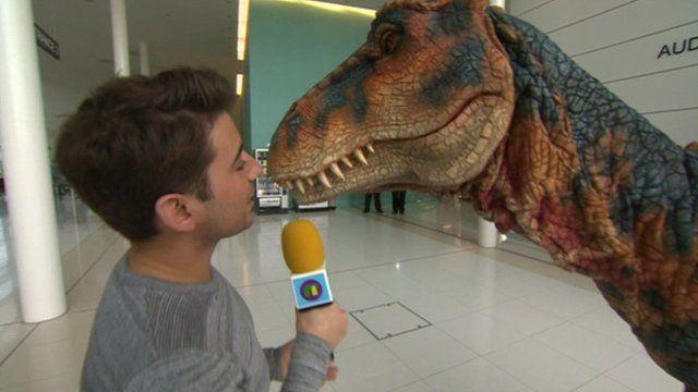Dinosaur steals Ricky's microphone