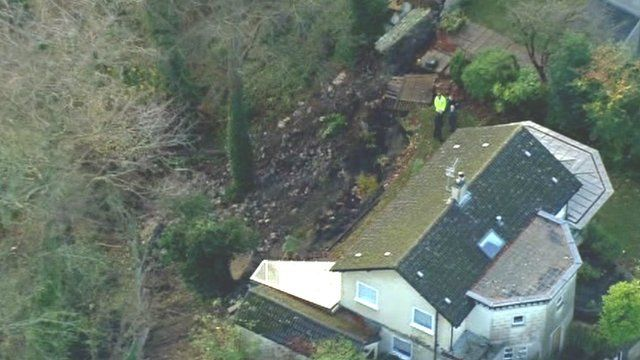 Helicopter shot showing damaged homes