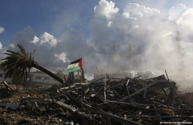 Smoke rises from the rubble of a Hamas government building destroyed on Wednesday.