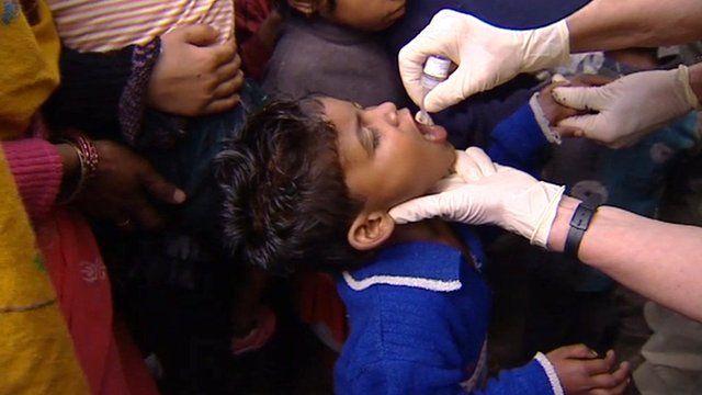 Child receiving polio vaccine