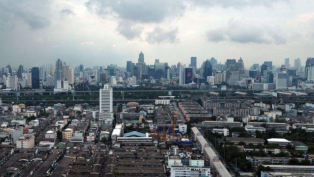 clouds loom over the Bangkok skyline
