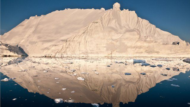 An iceberg and its reflection in Disko Bay, Greenland