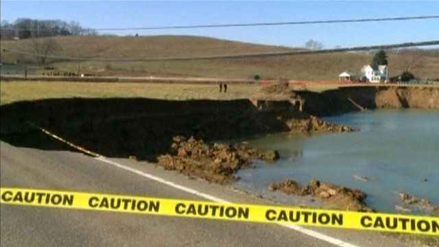 Sinkhole affecting road and nearby house