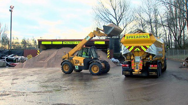 Grit loaded onto a gritter on a depot