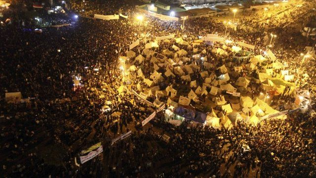 Tents lit up at night in Tahrir Square