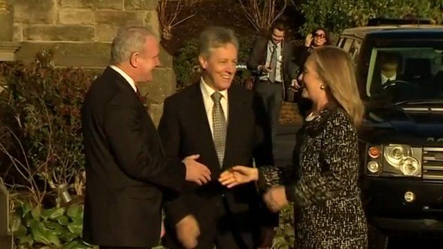 Hillary Clinton is greeted in Belfast by Peter Robinson and Martin McGuinness