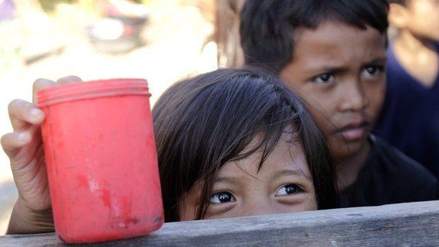 Children wait for porridge