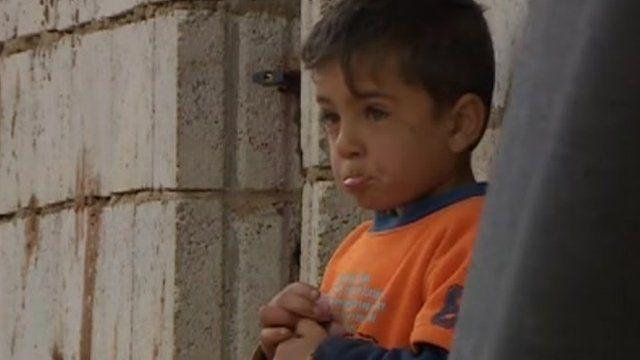 Boy in Syrian refugee village