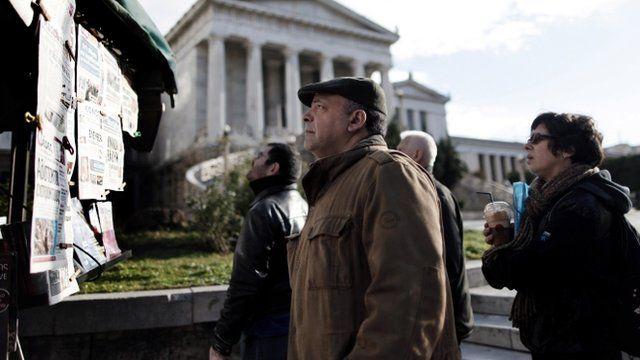 Greek residents reading newspapers