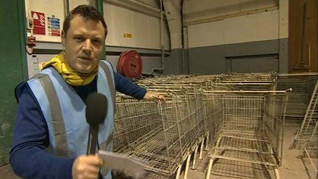Dominic Laurie with pre-restored shopping trolleys