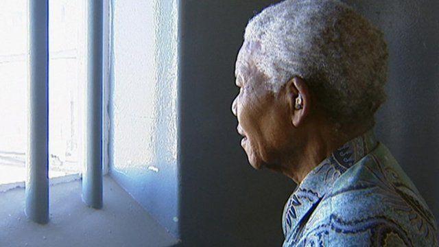 Mandela looks through prison bars