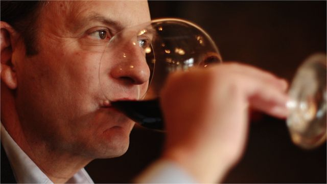Paul Lukacs drinking wine
