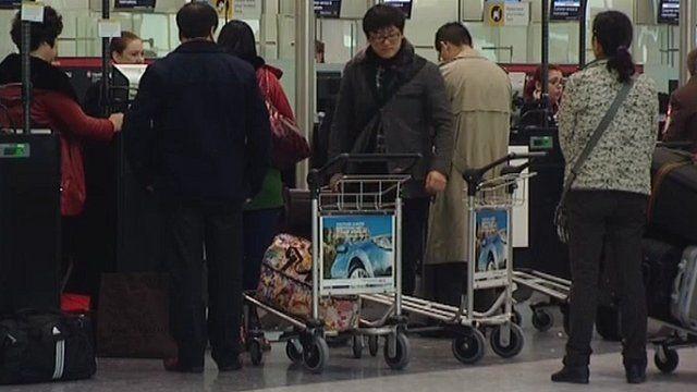 Passengers at Heathrow Airport